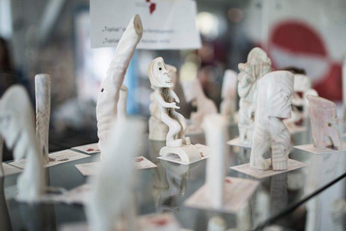 Tupilaks of bone carvings on display. Photo by Greenland Sagalands