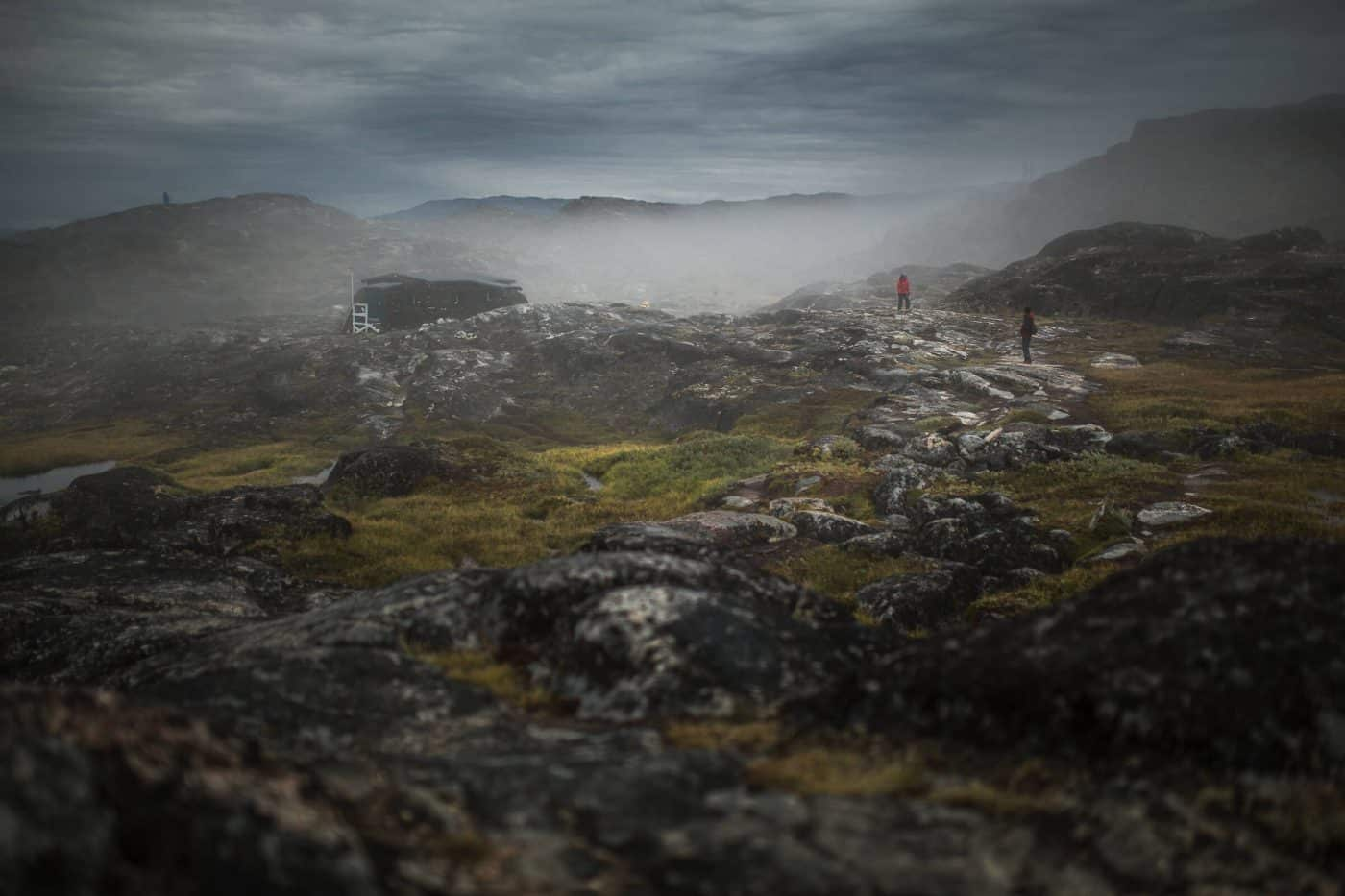 Hikers in the fog on a trail near Ilulissat in Greenland. By Mads Pihl