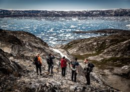Hikers overlooking Sermilik Ice Fjord in East Greenland. By Mads Pihl