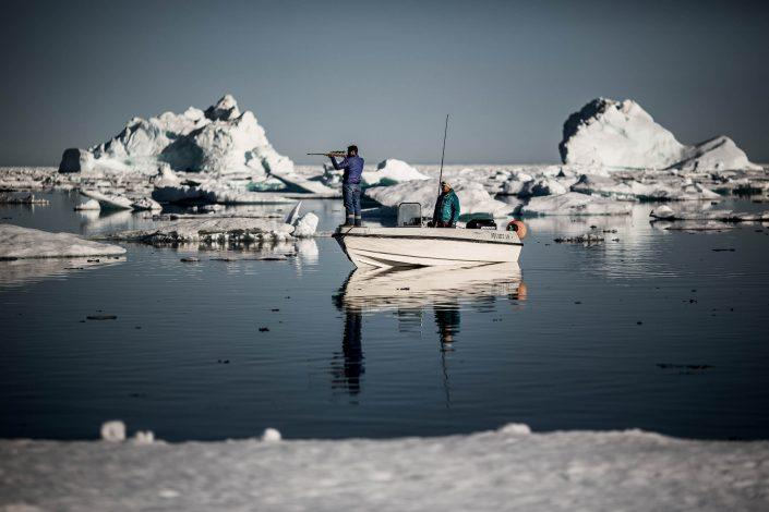 Hunting Culture - Two hunters in the sea ice near Tasiilaq in East Greenland