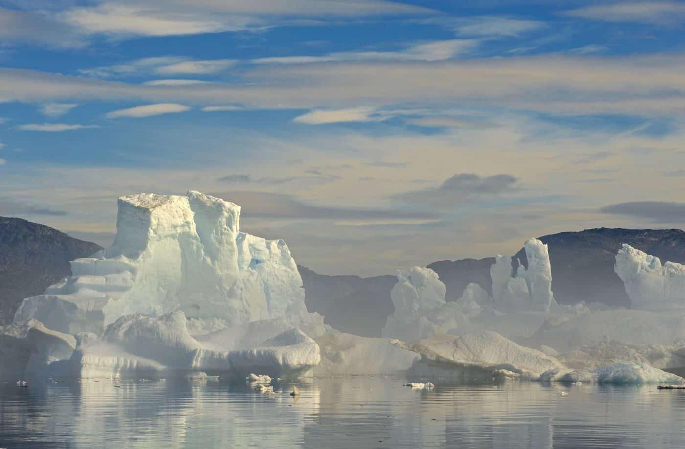 Icebergs in the mist in the Disko Bay, Greenland, by David Buchmann