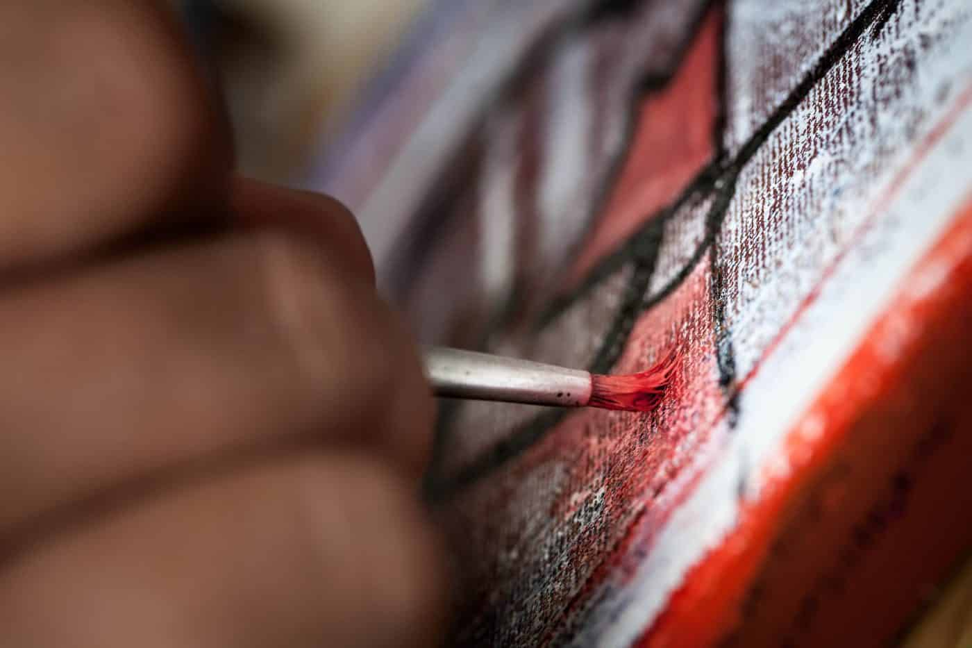 Kiistaaraq, a painter from Sisimiut in Greenland, at work - by Mads Pihl