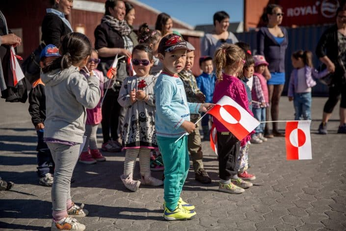 Kindergarden kids welcoming guests in Qasigiannguit in Greenland, by Mads Pihl