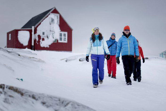 Skiers on a walk in Kulusuk near Kulusuk Hostel in East Greenland. Photo by Mads Pihl - Visit Greenland