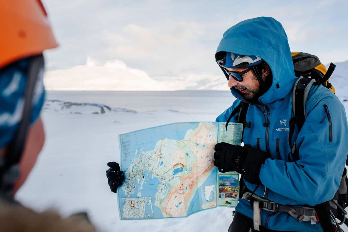 Mountain guide Marc Carreras showing hike route on Nuuk map in Greenland. By Rebecca Gustafsson