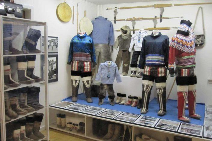 The National Costume of Greenland on display alongside kamiks, anoraks, drums, harpoons, pictures and jewelry. Photo by Nanortalik Museum