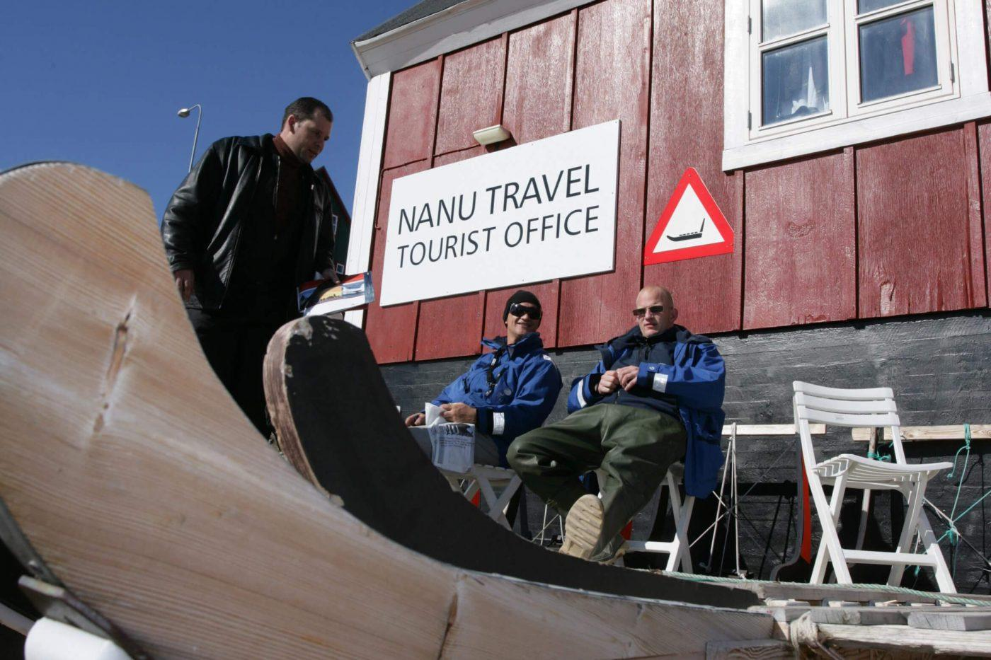 Three men enjoying the sun in front of Nanu Travel Tourist Office. Photo by Nanu Travel