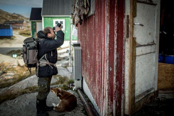 A photographer focusing on the small details in Kuummiut in East Greenland. Photo by Mads Pihl - Visit Greenland