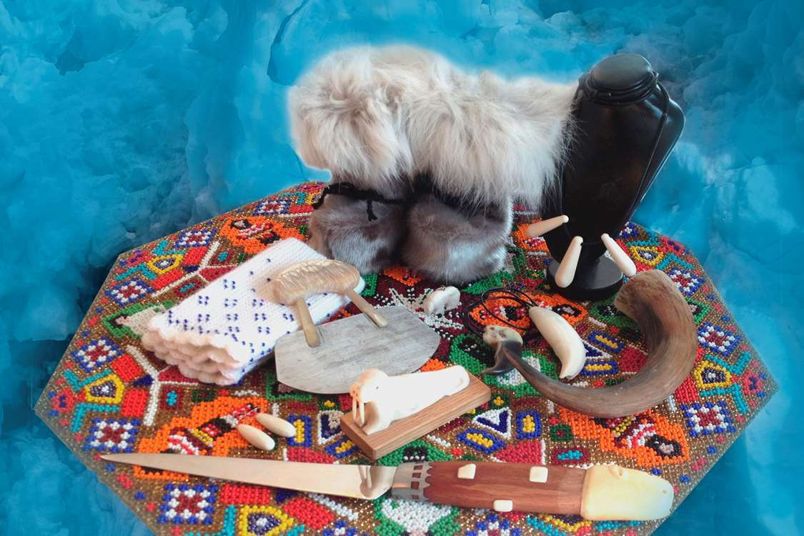 Traditional and cultural goods from Greenland, sealskin boots, ulu, bone carvings, jewelry and more. Photo by Nanu Travel