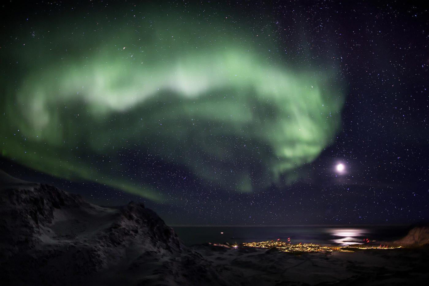 Northern Lights over the town of Sisimiut. Photo by Mads Pihl