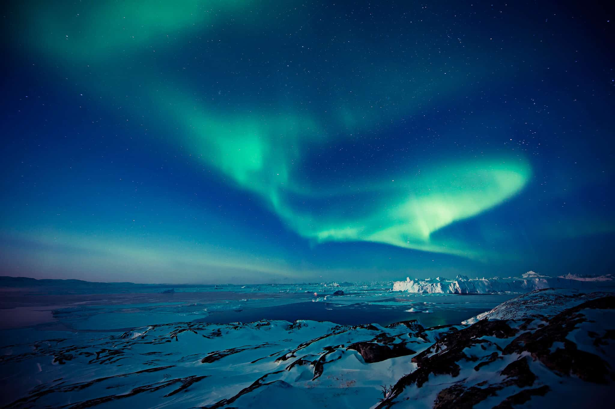 Northern lights over Ilulissat Icefjord. Photo by Andre Schoenherr