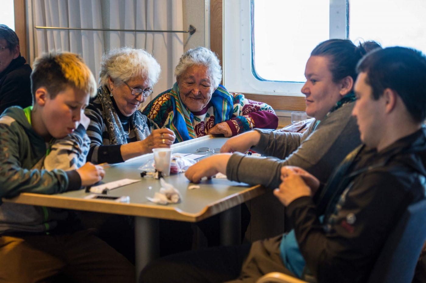 Passengers sharing the table in Cafe Sarfaq in the coastal ferry Sarfaq Ittuk in Greenland. Photo by Mads Pihl