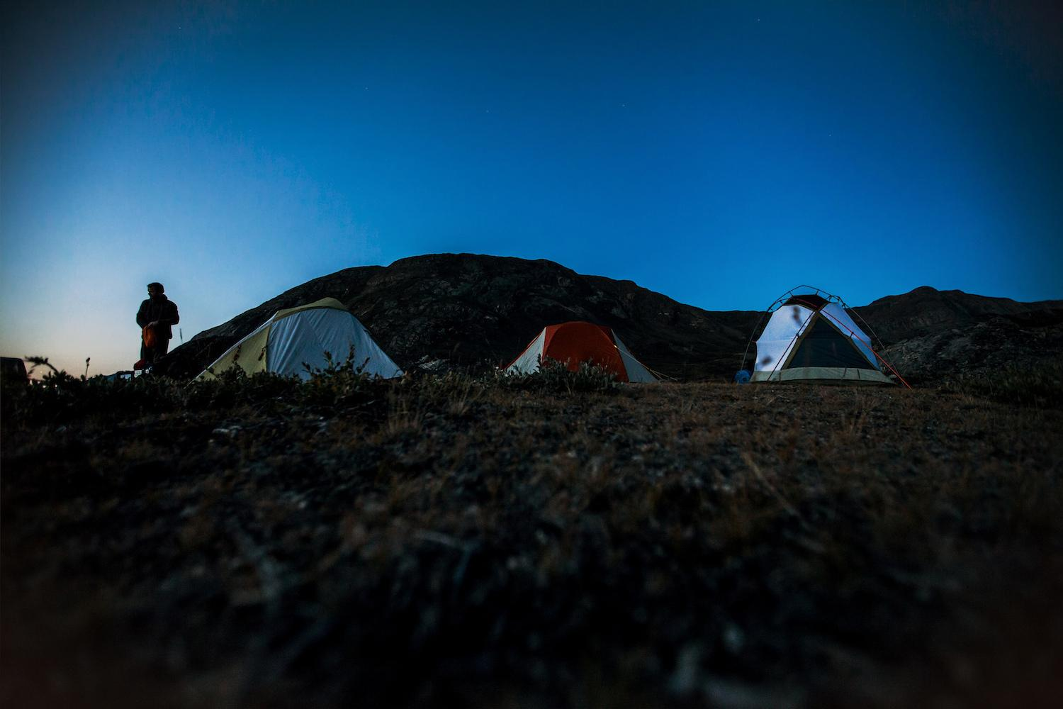 Tourists camping in a tent at Polar Lodge in Kangerlussuaq, Greenland. Photo by Mads Pihl
