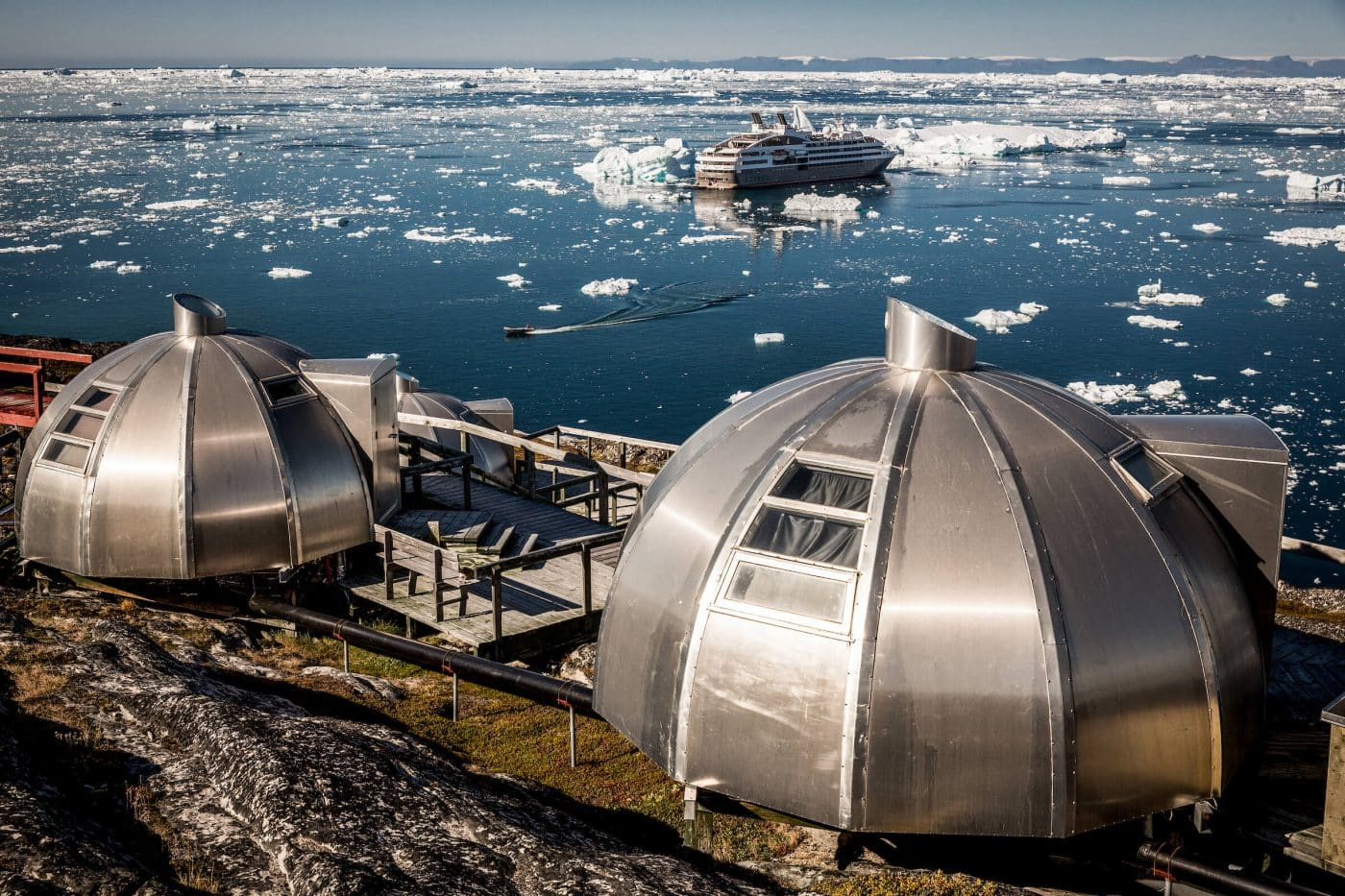 Ponant Cruises' L'Austral in front of the Hotel Arctic igloos in Ilulissat in Greenland. Photo by Mads Pihl