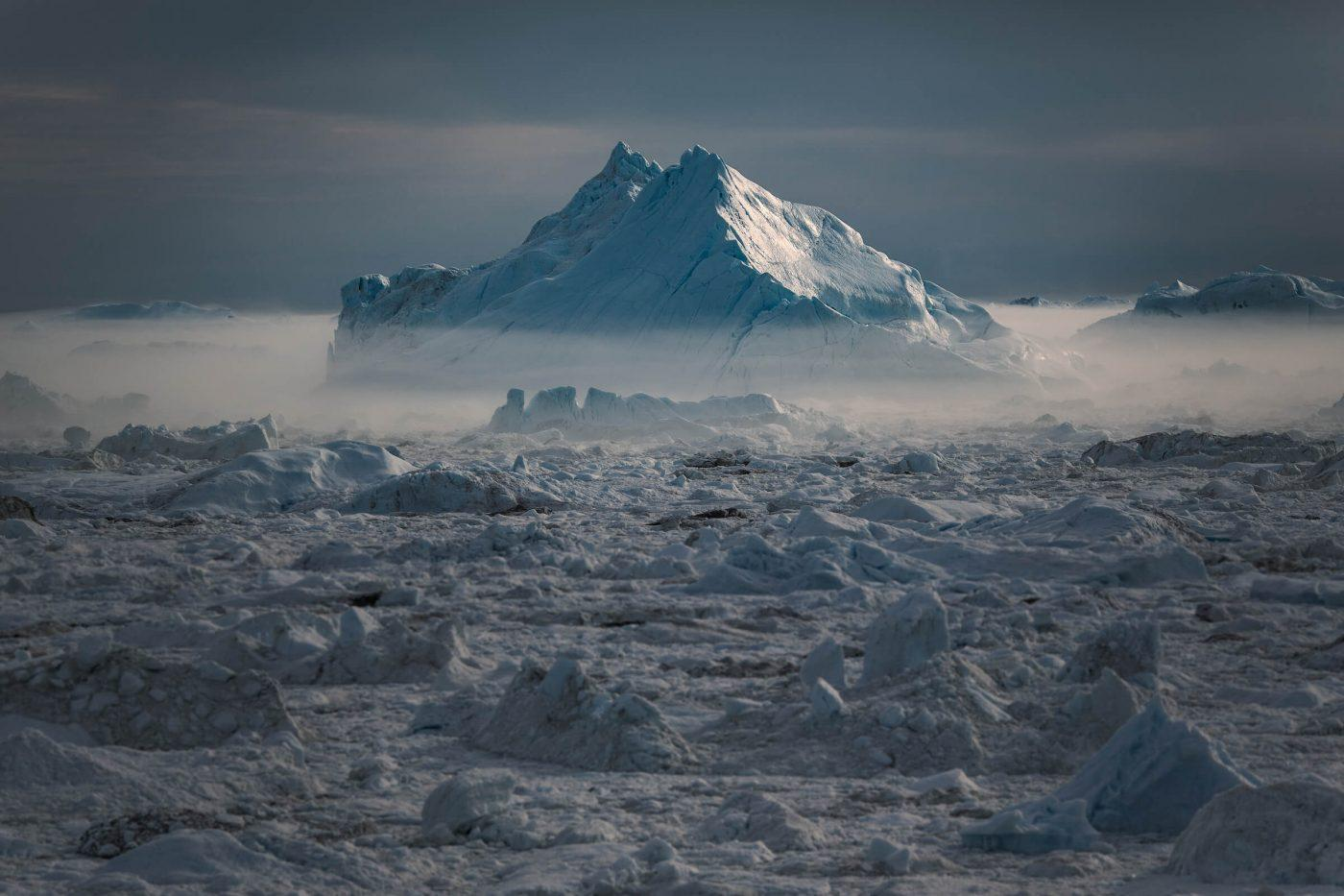 An iceberg in mist at sunset in the Ilulissat ice fjord in Greenland. Photo by Mads Pihl.jpg