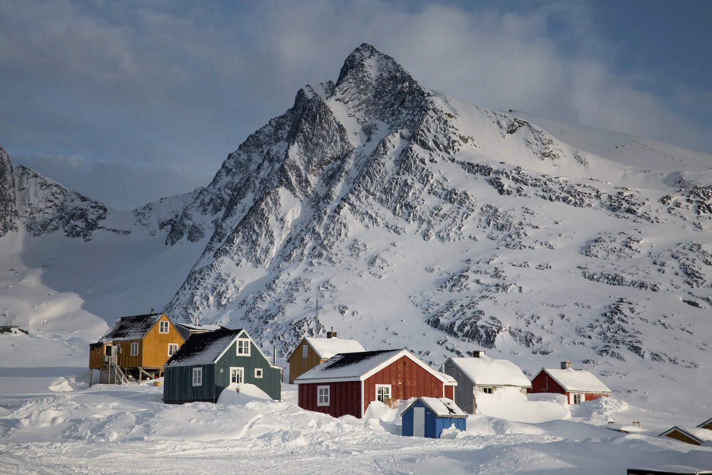 Snow-covered houses in Kuummiut, East Greenland. Photo by Mads Pihl