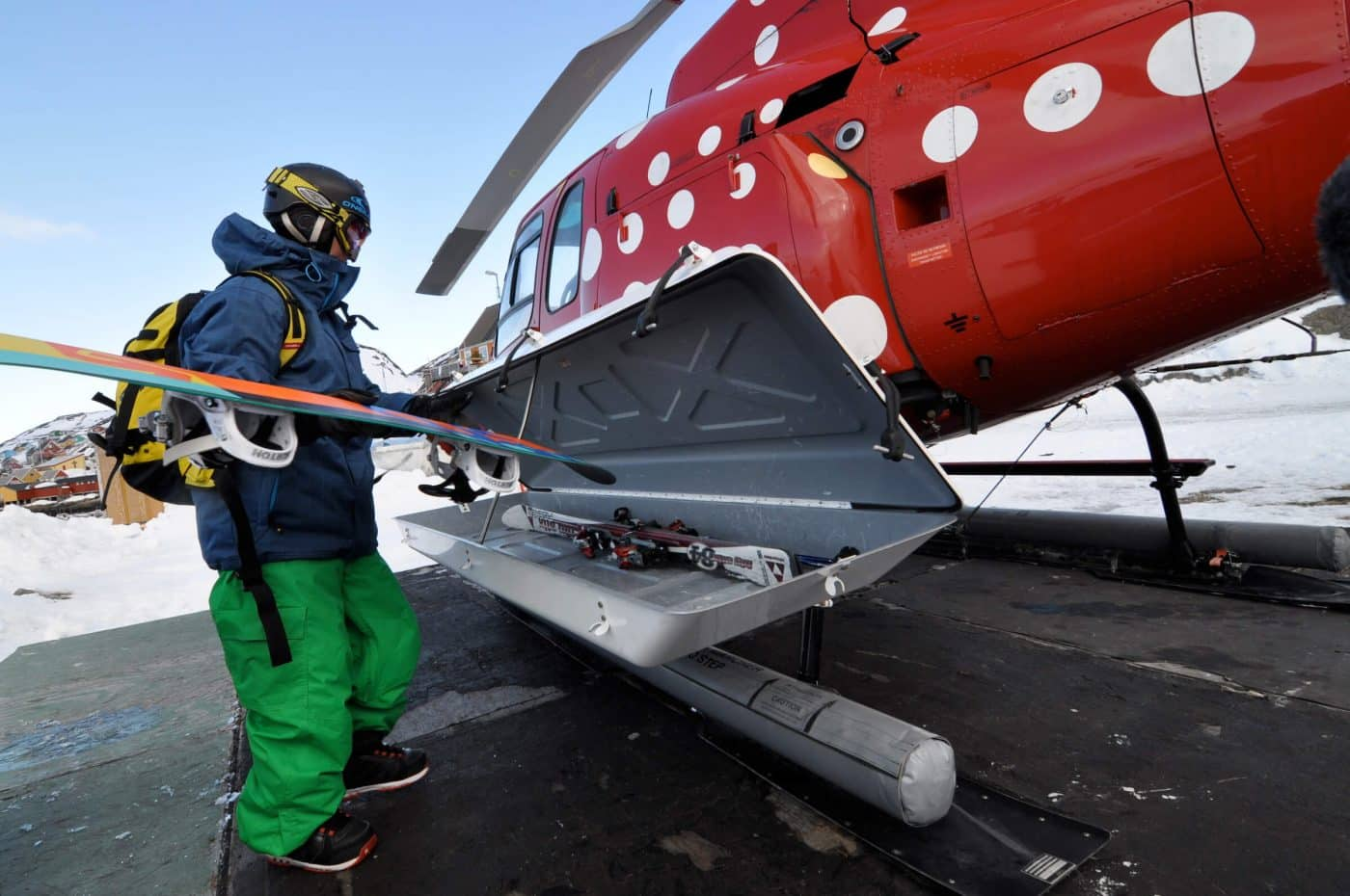 Stefan Gimpl loading up the gear to go heliboarding near Kangaamiut and the Eternity Fjord in Greenland. By Mads Pihl