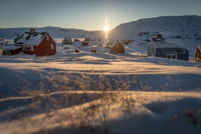 Sunrise over the village Oqaatsut in North Greenland near Ilulissat in the Disko Bay