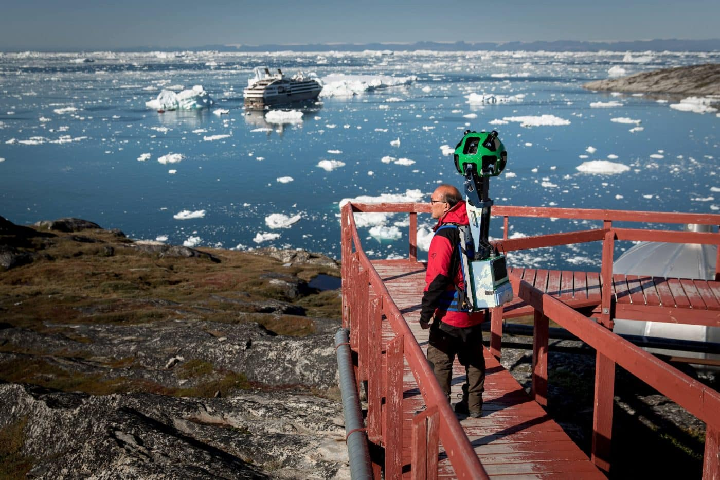The Google Street View trekker at work near Hotel Arctic in Ilulissat in Greenland. By Mads Pihl