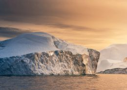 The warm hues of a sidelit sunset scene in the Ilulissat Icefjord. It felt like a fairytale being able to slowly sail around the icebergs and position myself perfectly for the type of image I wanted. By Stian Klo