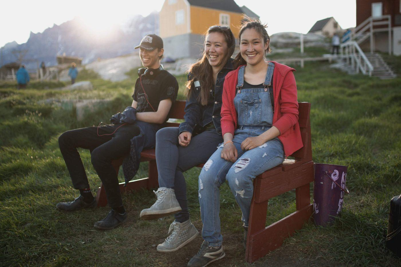 Three young people in the sunset in Ukkusissat, Greenland. Photo by Mads Pihl