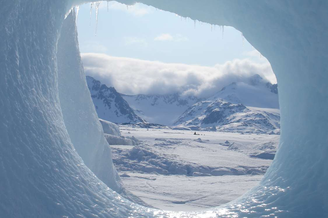 Landscape in East Greenland with snowy mountains. Photo by Arctic Dream, Visit Greenland
