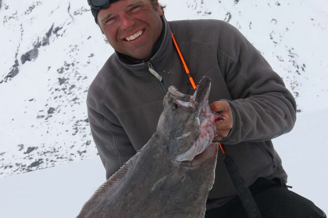Lars proudly presenting his catch from a fishing trip. Photo by Arctic Dream, Visit GreenlandArctic Dream Travellodge Greenland 18
