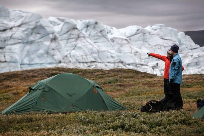 Two hikers at a tent camp by Russell Glacier near Kangerlussuaq in Greenland. By Mads Pihl
