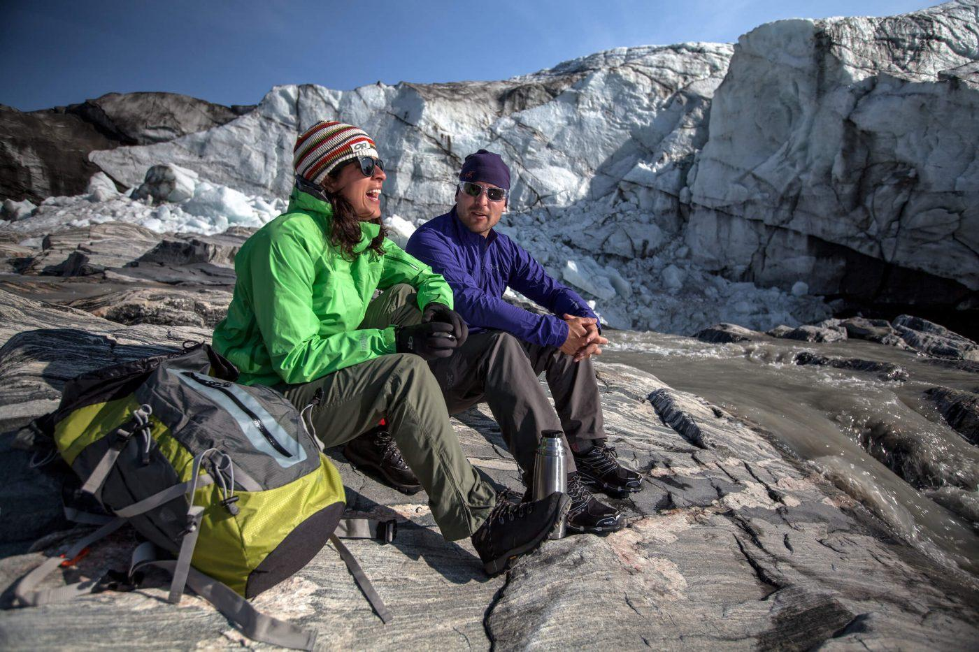 Two hikers enjoying a day in the sun by the Russell Glacier near Kangerlussuaq in Greenland. Photo by Mads Pihl
