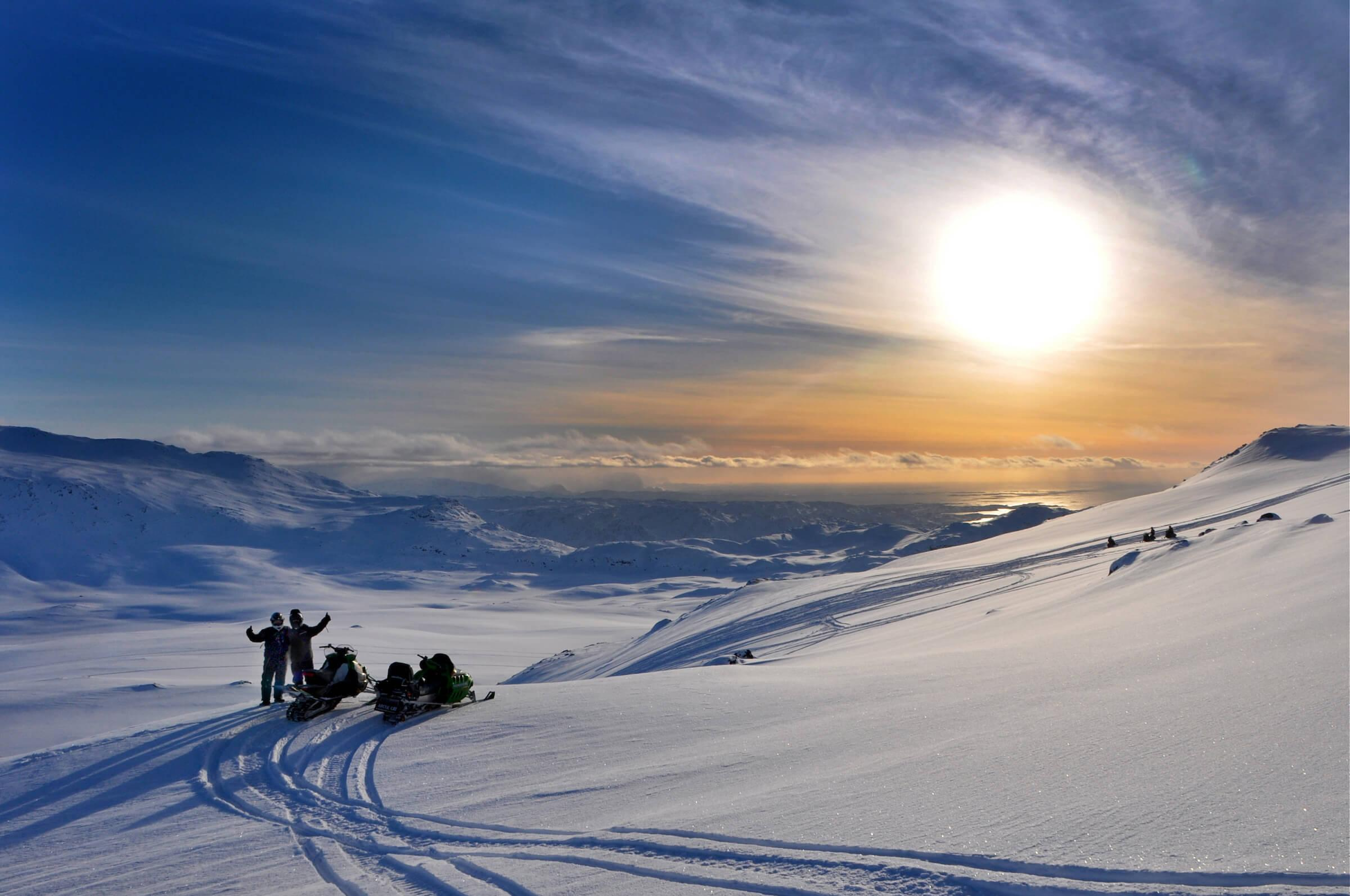 Two snowmobilers in the backcountry near Sisimiut in Greenland. Photo by Mads Pihl.