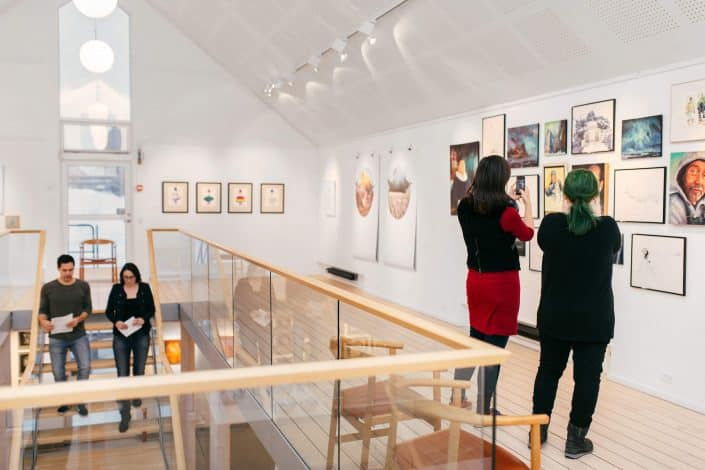Visitors of Nuuk Art Museum taking photos of the Kimik exhibition in Nuuk, Greenland. By Rebecca Gustafsson