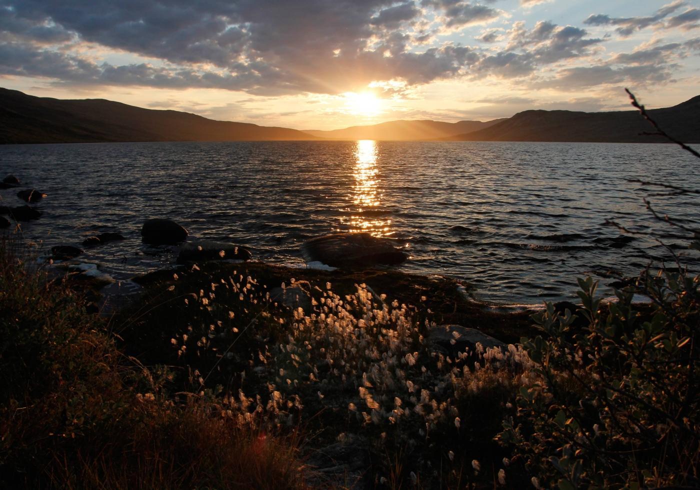 Beautiful sunset at Tasersuatsiaq. Photo by Filip Hanzak - Visit Greenland