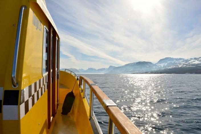 Boat deck view of ocean on a sunny day. Photo by Nuuk Water Taxi