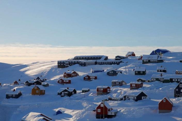 City view of Tasiilaq with Hotel Angmagssalik at the top of a hill in winter. Photo by Hotel Angmagssalik - Visit Greenland
