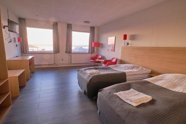 Large double room with view over the coast. Photo by Lisa Germany, Visit Greenland