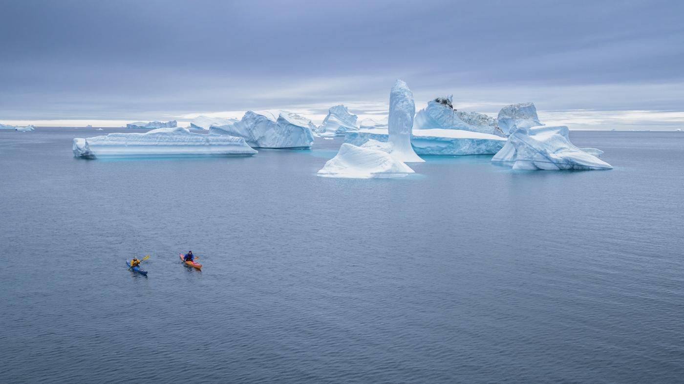 Kayaking between giant icebergs. Photo Henrik Kaarsholm – Hotel Disko Island , Visit Greenland