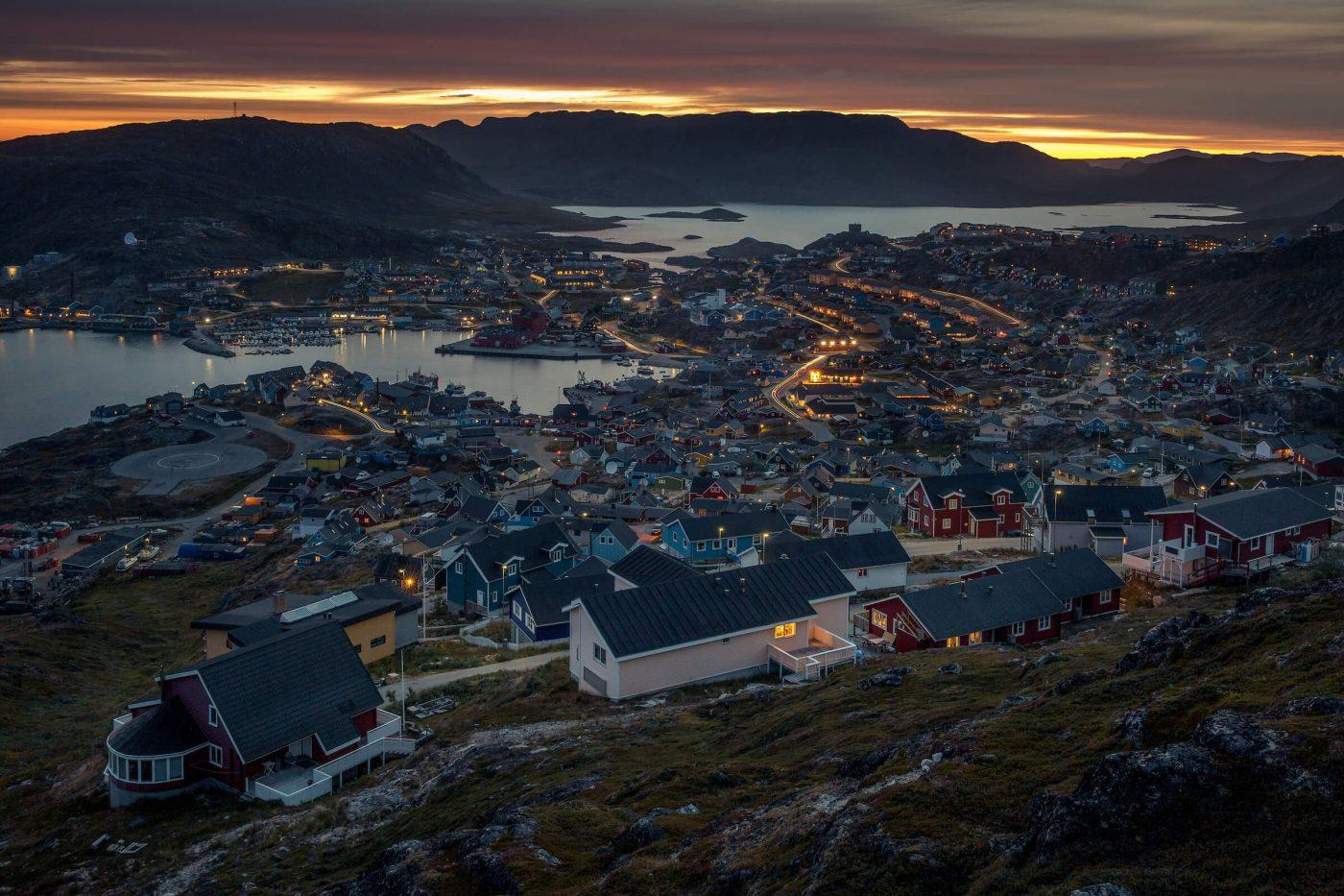 A nighttime panoramic view of Qaqortoq in South Greenland. Photo by Mads Pihl.