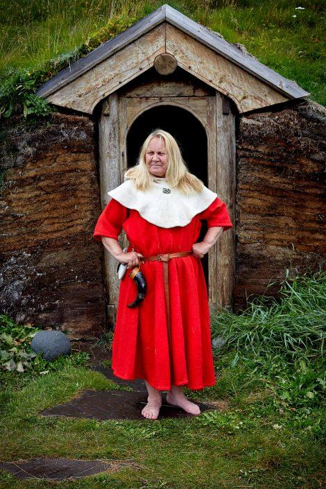 Norse woman in front of Viking church reconstruction, Qassiarsuk. Photo by Mads Pihl.