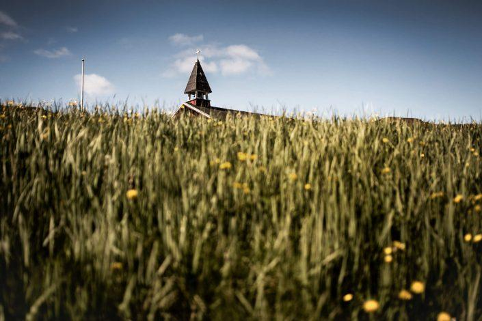 The bell tower on the church at Qassiarsuk in South Greenland. Photo by Mads Pihl