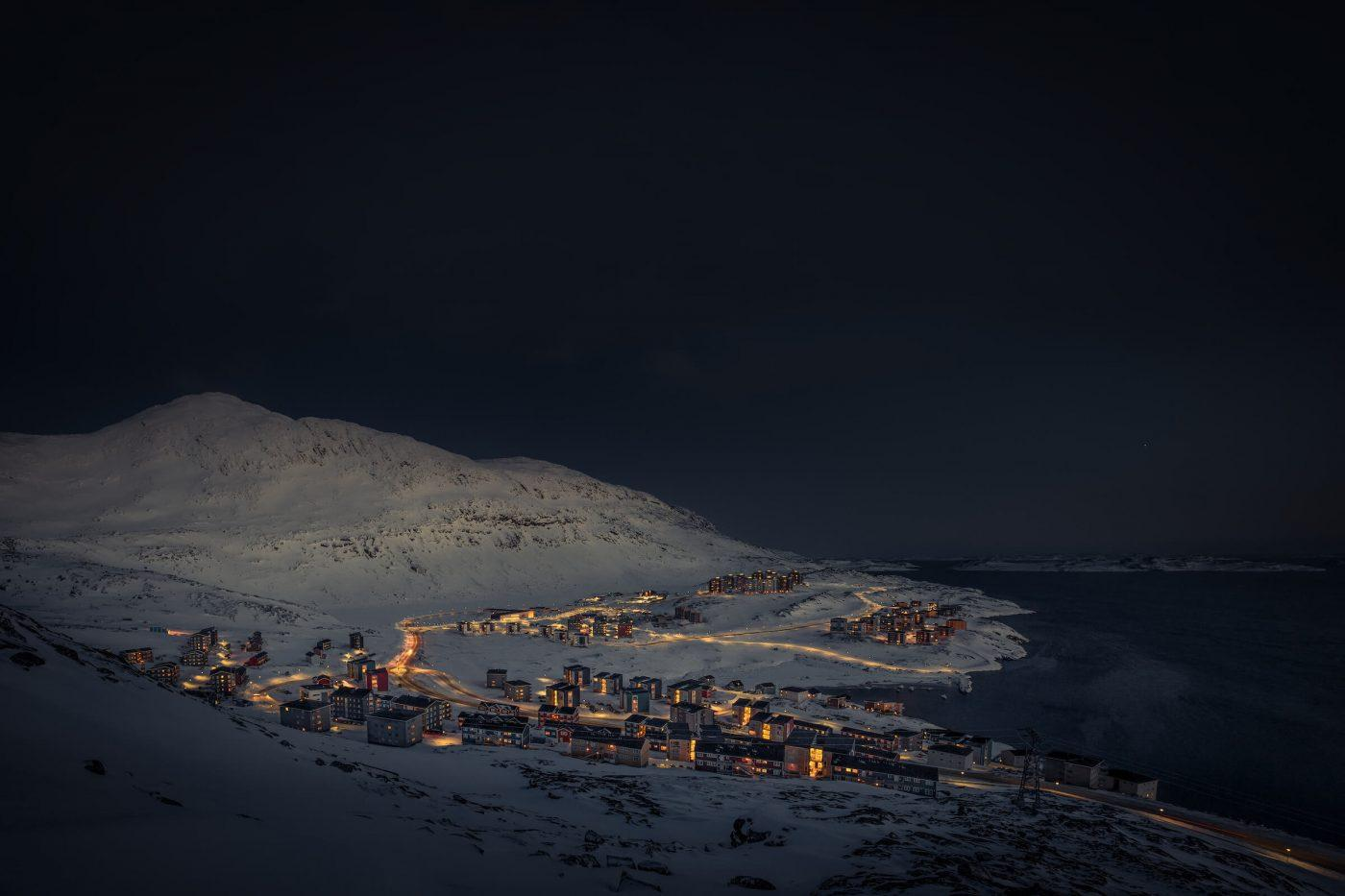A winter evening view over the Nuuk suburb Qinngorput in Greenland. By Mads Pihl