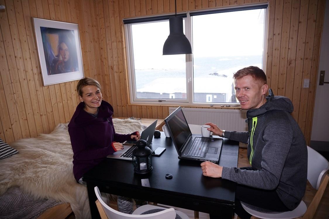 Two travelers in a cabin working. By Anna Szczypczynska