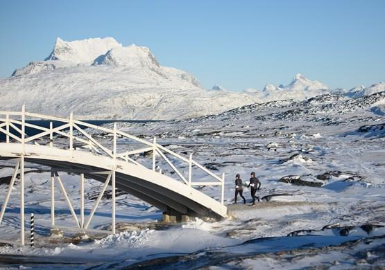 Two Runner's running towards a bridge. By Bo Kristensen
