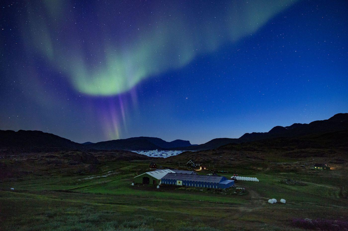 Northern lights over Tasiusaq sheep farm in South Greenland. By Mads Pihl