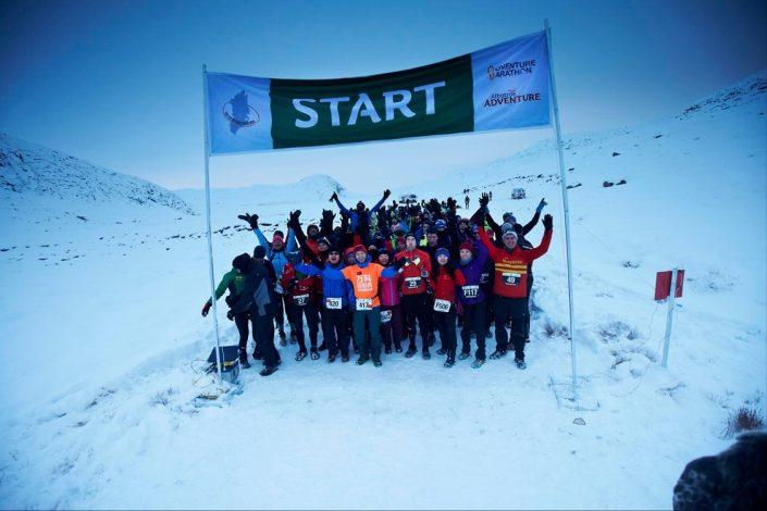 Polar Circle Marathon Participants ready for start. Happy man and woman posing at the polar circle marathon. By Visit Greenland
