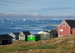 Qaanaaq, with view over the sea towards Herbert Island. Photo by Glenn Mattsing - Visit Greenland