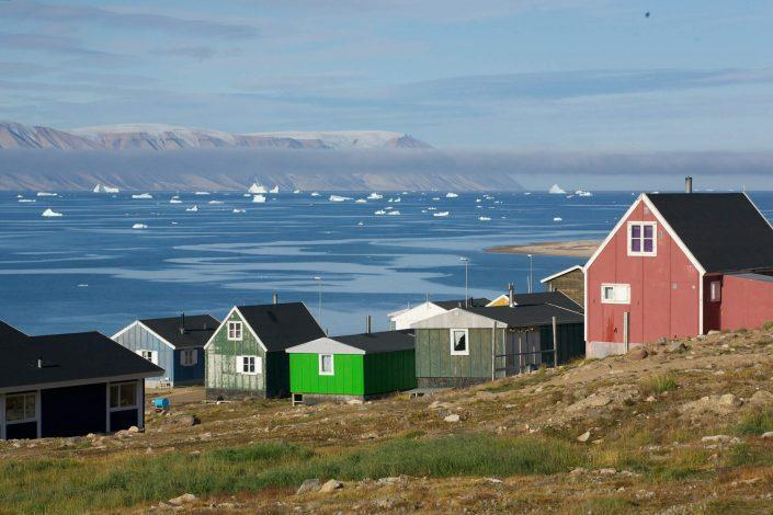 Qaanaaq, with view over the sea towards Herbert Island. Photo by Glenn Mattsing.