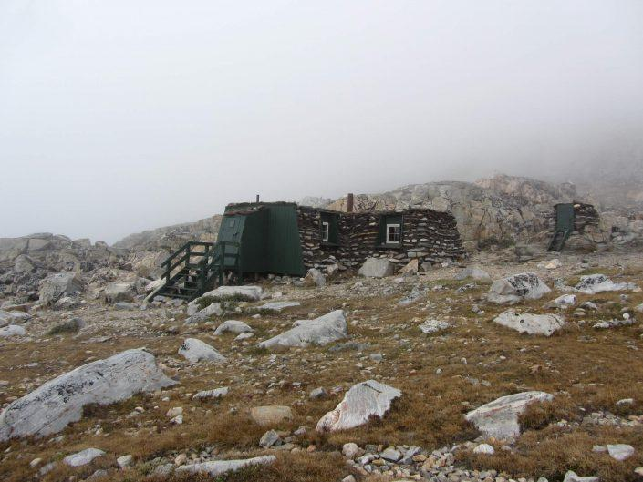 Inuit turf hut reconstruction on a foggy day outside Uummannaq in North Greenland, by Ella Grødem.