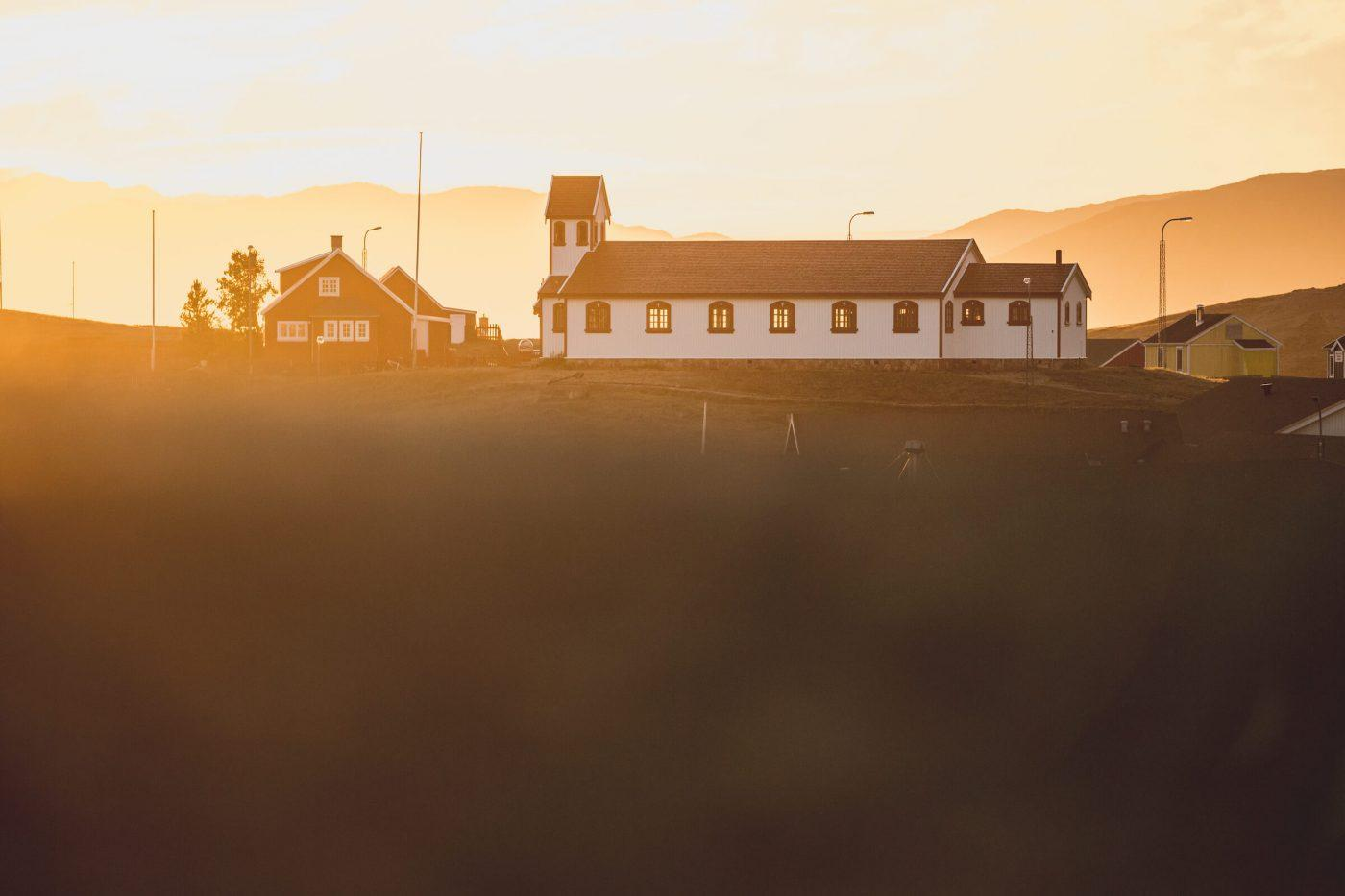 Sunset over the Narsaq church in South Greenland. Photo by Mads Pihl.