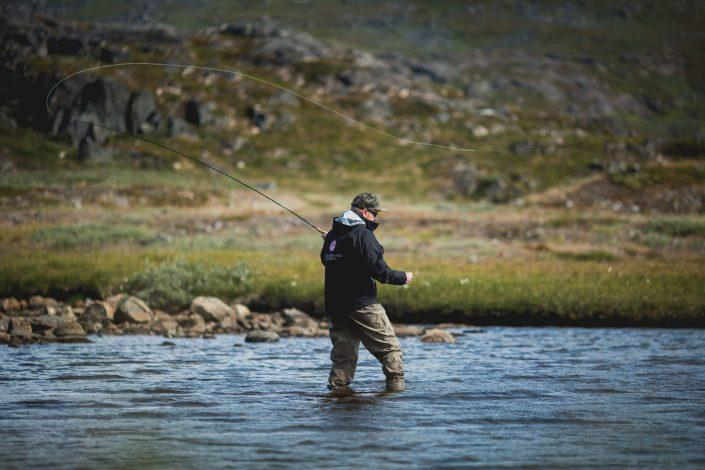 The guide from South Greenlanf Fly Fishing angling in the Narsaq backcountry. Photo by Mads Pihl.