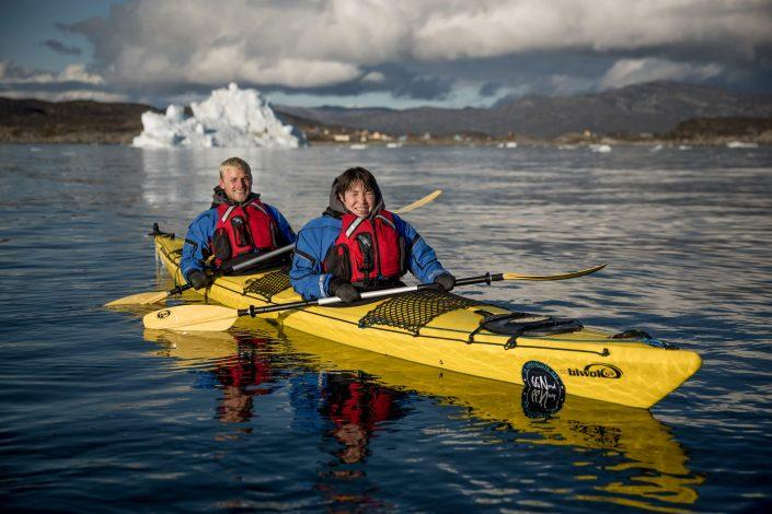 Two happy kayakers from PGI Greenland near Oqaatsut in Greenland. Photo by Mads Pihl.